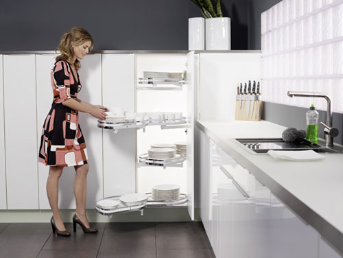 Recent-design-kitchen-with-black-tiles-flooring-white-kitchen-cupboards-white-worktop-and-modern-sink